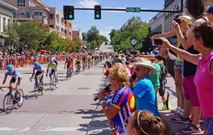 Coach Stacy and cycling enthusiast David Waugh emceeing the Final Stage of last month's USA Pro Challenge in Golden, Colorado